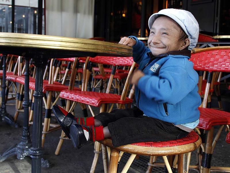 Nepalese Guinness World Record holder Khagendra Thapa Magar, 19, the second world's smallest man with 67 cm (26 inches), poses in a French cafe in Paris.