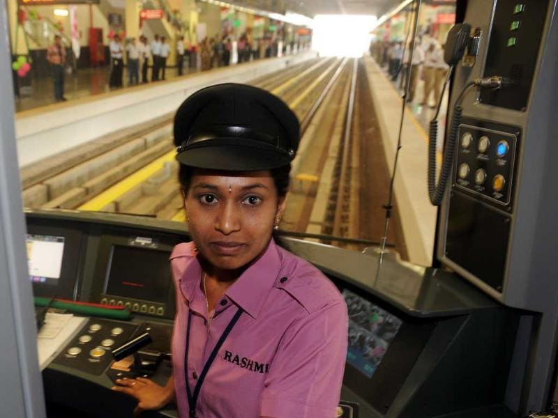 A driver for the Bangalore Metro Rail Corporation's Namma metro train, M Rashmi, poses for a photo during the inaugural run in Bangalore. (AFP)