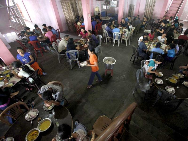 Ziona's family members eat breakfast at their residence in Baktawng village in Mizoram. (Reuters)