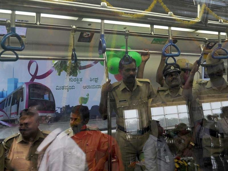 Passengers and police ride in the Bangalore Metro Rail Corporation's Namma metro during its inaugural run in Bangalore.