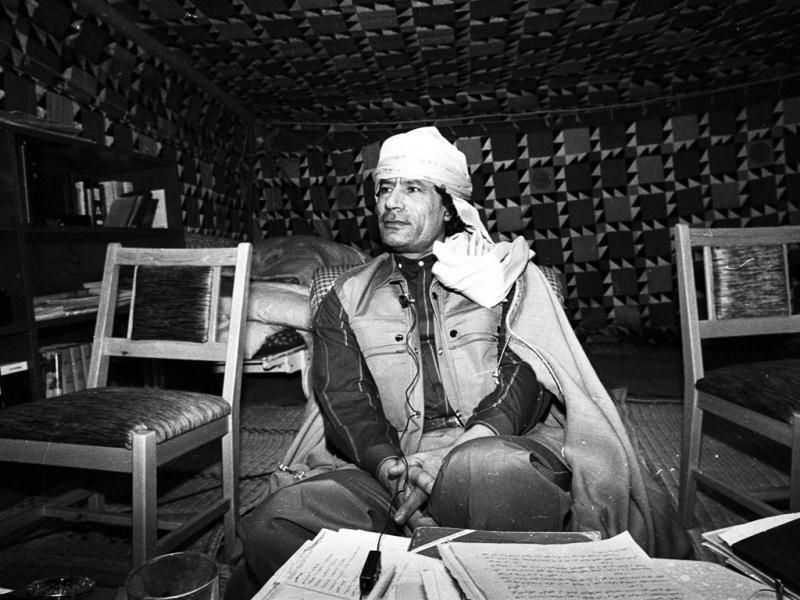 Libyan leader Muammar Gaddafi looks on during a news conference where he presented his family to US female journalists inside his Bedouin tent erected in the heavily fortified Bab El-Assaria barracks on the outskirts of Tripoli. (Files)