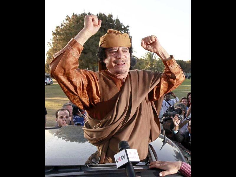 Libyan leader Muammar Gaddafi gestures from a car in Tripoli, after a meeting with a delegation of five African leaders seeking to mediate in Libya's conflict. (Files)