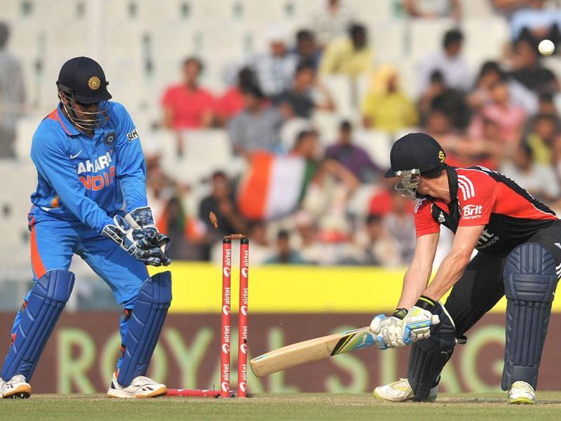 England cricketer Craig Kieswetter is bowled by Indian bowler Virat Kohli during the third One day International in Mohali.