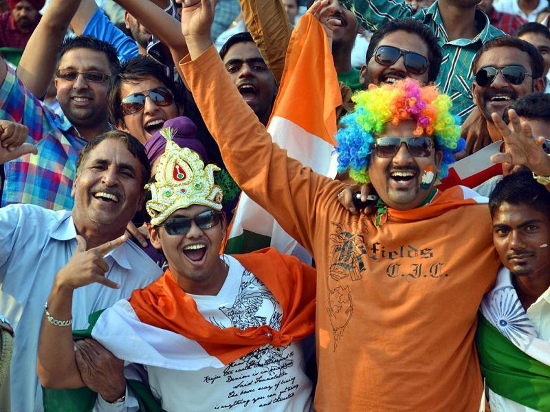 Fans cheering the team members during the third ODI one day match between India Vs England at PCA Stadium in Mohali. Photo by HT Photographer Rajnish Katyal.