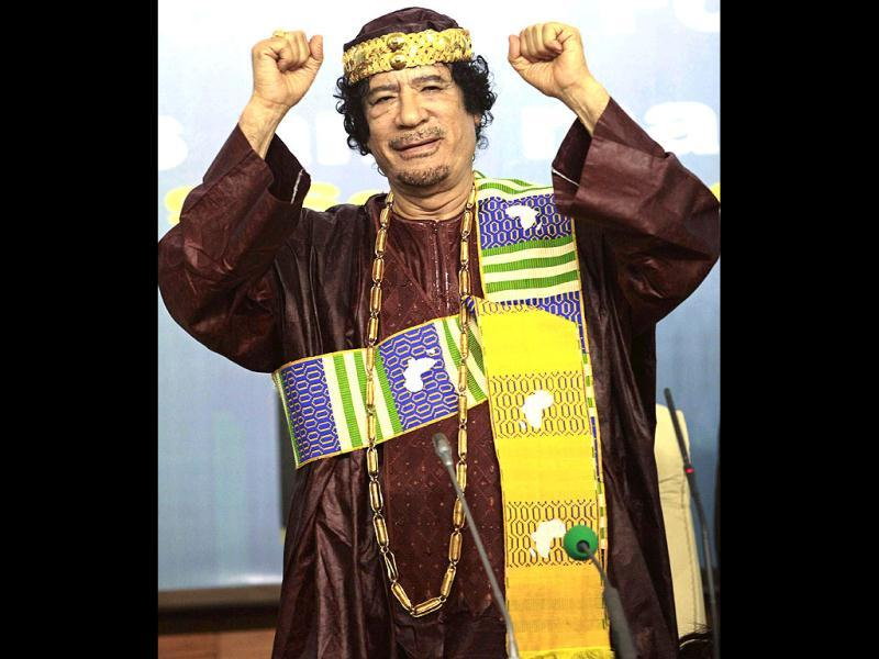 Libya's leader Muammar Gaddafi gestures as he attends the Second Forum for Kings, Sultans, Princes, Sheikhs and Mayors of Africa in Tripoli. (Files)