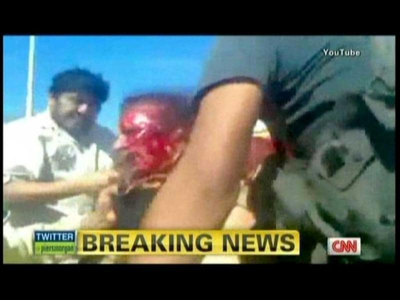 A still image from YouTube courtesy of CNN shows Libyan strongman Muammar Gaddafi, who was killed as new regime forces crushed the last pocket of resistance in his hometown Sirte, the National Transitional Council said. (AFP)