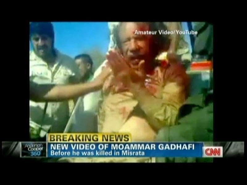 A TV grab from YouTube courtesy of CNN shows Libyan strongman Muammar Gaddafi moments before he was killed as new regime forces crushed the last pocket of resistance in his hometown Sirte. (AFP)
