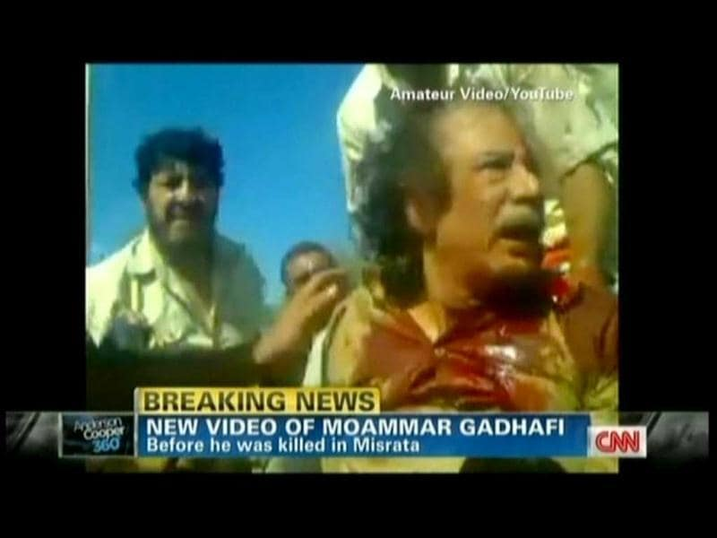 Muammar Gaddafi is seen in this TV grab from YouTube courtesy CNN moments before he was killed in his hometown Sirte. (AFP)