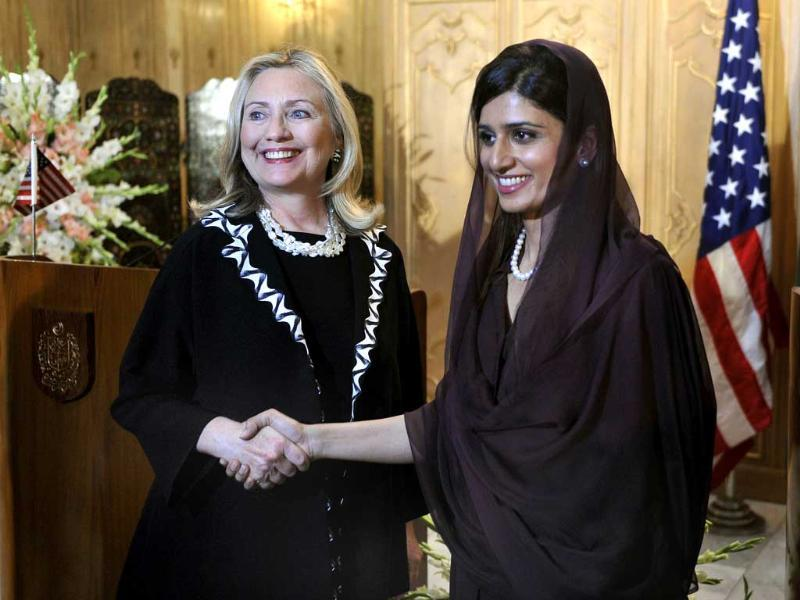 US secretary of state Hillary Clinton (L) shakes hands with Pakistan's foreign minister Hina Rabbani Khar after a joint press conference in Islamabad. (AFP)