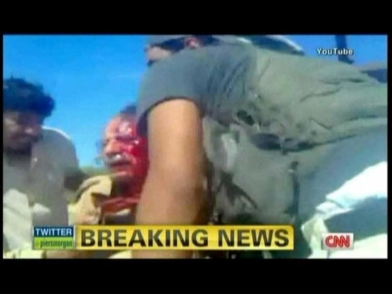 In this TV grab from YouTube courtesy CNN, Muammar Gaddafi is seen moments after he was captured by Libyan rebel forces in his hometown Sirte. (AFP)