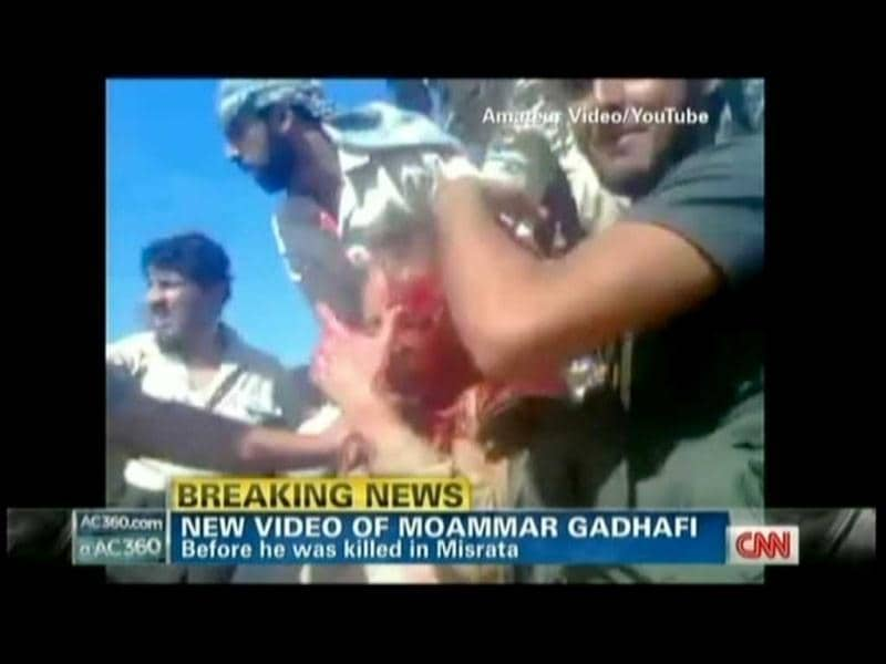 Muammar Gaddafi is seen in the amateur TV grab from YouTube courtesy CNN, covered in blood moments after he was captured by Libyan rebel forces in his hometown Sirte. (AFP)
