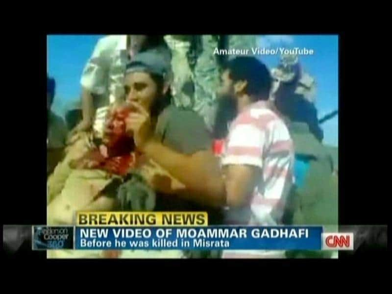 Libyan rebels are seen holding on to Muammar Gaddafi moments after he was captured. TV grab from YouTube courtesy CNN (AFP)