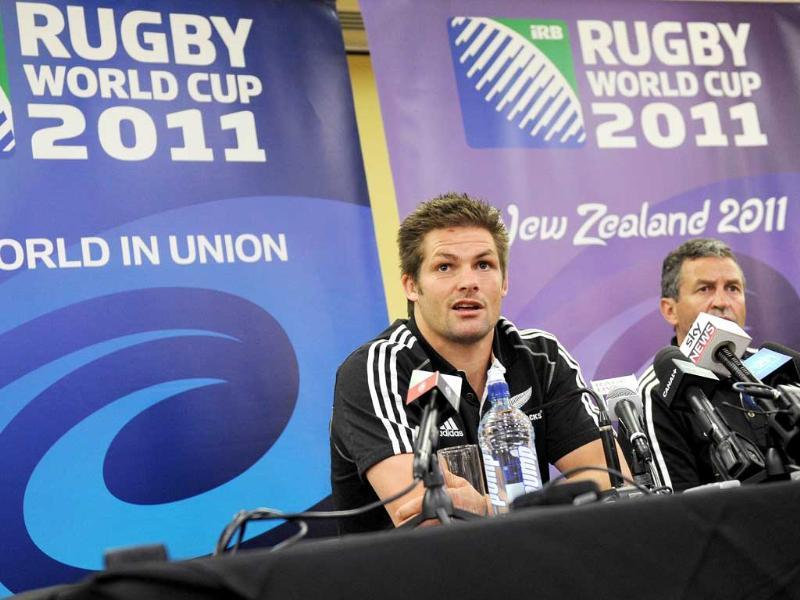 New Zealand All Black captain Richie McCaw (C) and assistant coach Wayne Smith (R) speak during a press conference, in Auckland. (AFP)