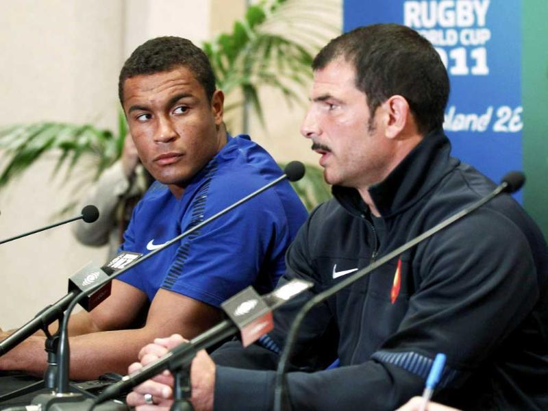 France captain Thierry Dusautoir (L) and coach Marc Lievremont attend a news conference in. (Reuters)
