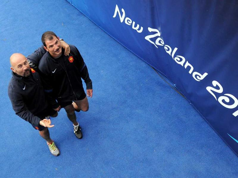 France's fitness coach Jean Luc Arnaud (L) and head coach Marc Lievremont leave the pitch at the end of the Captain's Run at the Eden Park stadium in Auckland. (AFP)