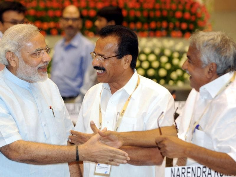 Chief ministers of Gujarat, Narendra Modi (L), Kerala Omman Chandi (R) and Karnataka Sadananda Gowda greet each other as they arrive for the inauguration of the 56th meeting of the National Development Council (NDC), in New Delhi. (AFP Photo )