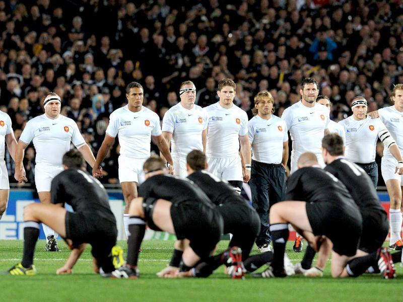 The French team (white) advance to receive the challenge of the New Zealand All Black Haka before the 2011 Rugby World Cup final match at Eden Park stadium in Auckland.