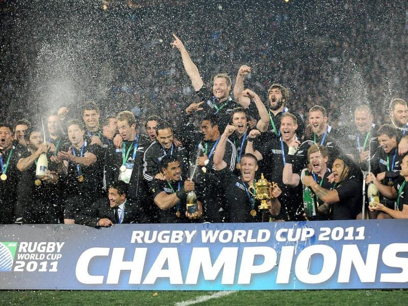 New Zealand All Blacks lock Brad Thorn holds the Webb Ellis cup with his players after the 2011 Rugby World Cup final match at Eden Park stadium in Auckland.