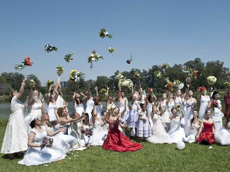 Women wearing bridal dresses take part in a bride parade, in Sao Paulo, Brazil. Around 40 brides took part in the event organized to promote family tradition, marriage and maternity.