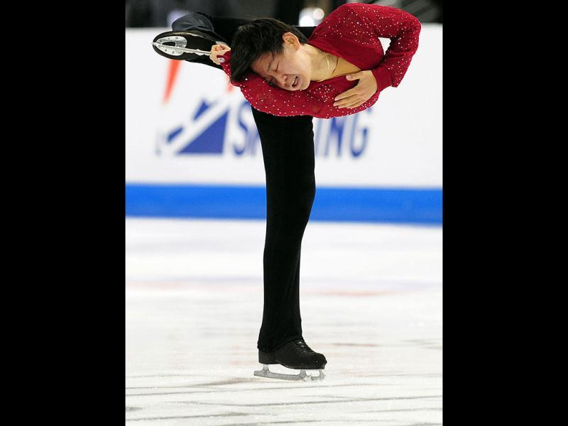 Dennis Ten of Kazakhstan performs during the men's free skate event at the Citizens Business Bank Arena in Ontario, California, during Skate America, the first event of the ISU figure skating Grand Prix series.
