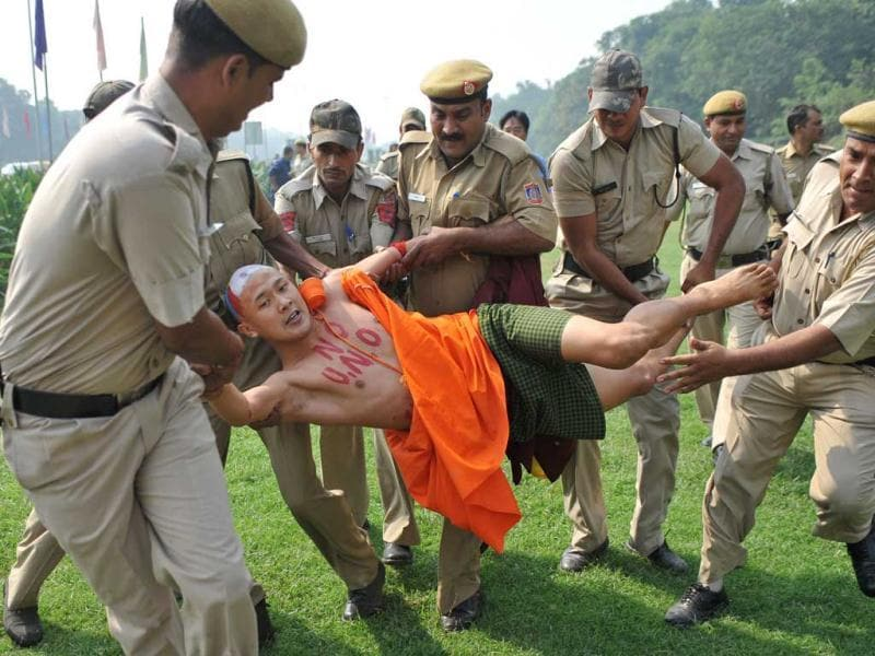 A Tibetan Buddhist monk in-exile is detained by Indian police officers during a protest outside The Chinese Embassy in New Delhi. Tibetan Monks and demonstrators protested outside the Chinese embassy in the Indian capital after a spate of self-immolation by Buddhist monks in Tibet.