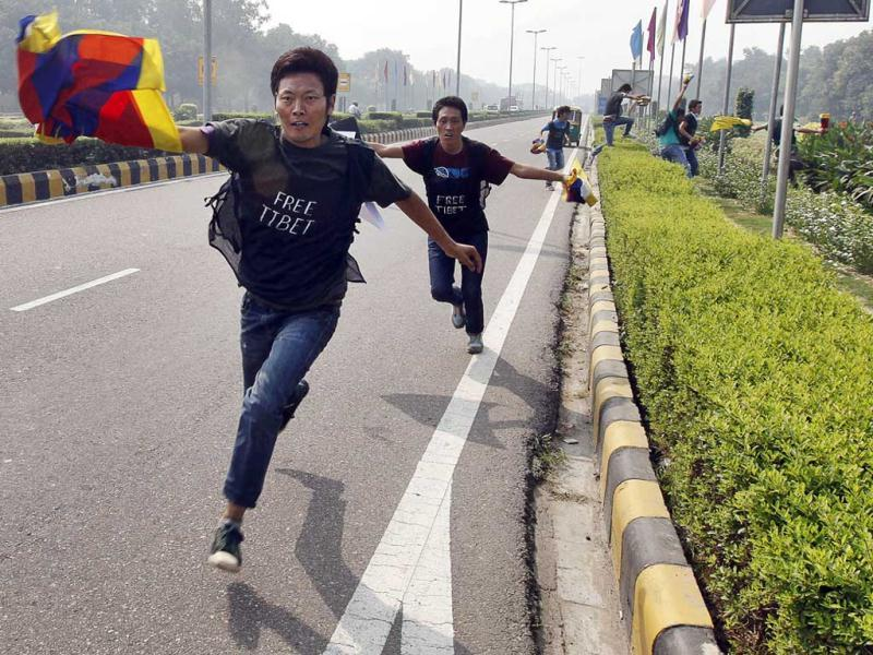 Tibetan exiles shout slogans as they run towards Chinese Embassy at a protest in New Delhi. The protest was held to express solidarity with the plight of people in Tibet who set themselves on fire in protest against Chinese rule.