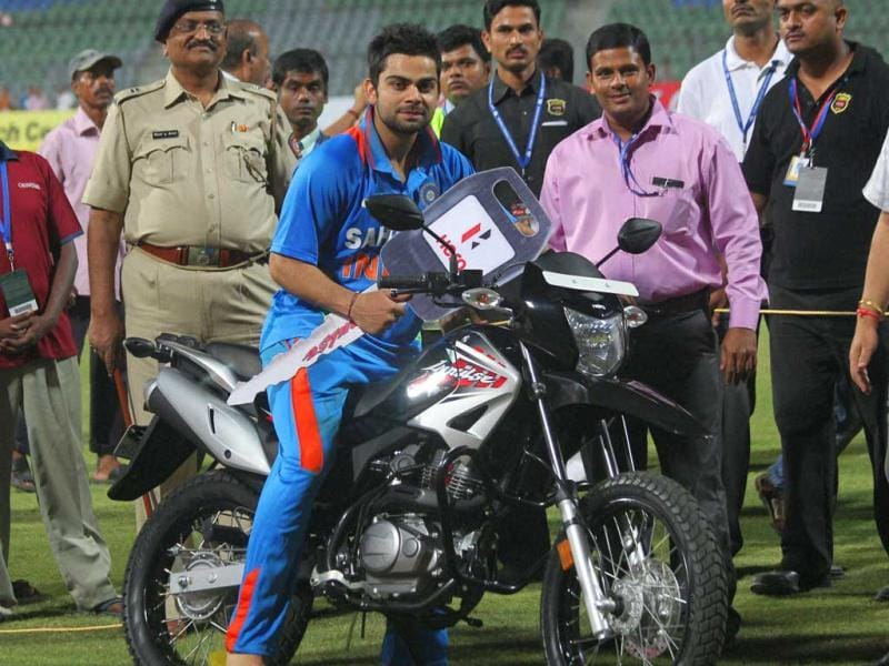 Batsman Virat Kohli poses for photographers after reciving best Performance Award of the match during the 4th India England ODI at the Wankhade stadium in Mumbai.