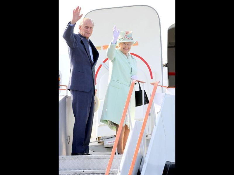 Britain's Queen Elizabeth II and her husband Prince Phillip wave farewell to the people of Brisbane, Australia, after their visit.