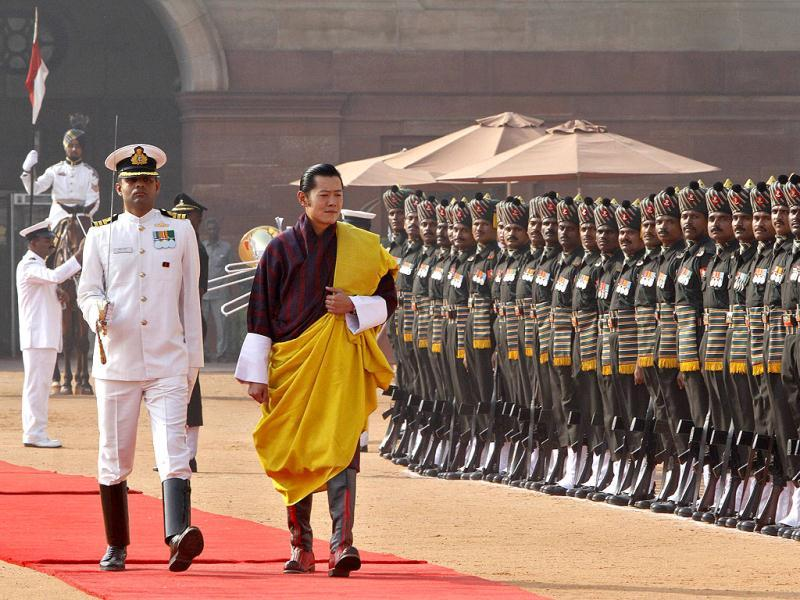 Bhutan's King Jigme Khesar Namgyel Wangchuck (2nd L) inspects a guard of honour during his ceremonial reception at the Rashtrapati Bhavan in New Delhi. (Reuters)