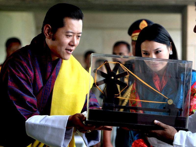 Bhutan's King Jigme Jigme Khesar Namgyel Wangchuck and his wife Queen Jetsun Pema receive a 'charkha' as a memento after paying homage to Mahatma Gandhi at Rajghat, in New Delhi. (PTI)