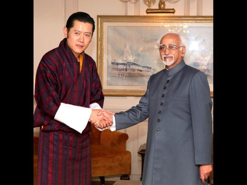 Bhutan's King Jigme Khesar Namgyel Wangchuck shakes hands with vice president Hamid Ansari during a meeting in New Delhi. (PTI)