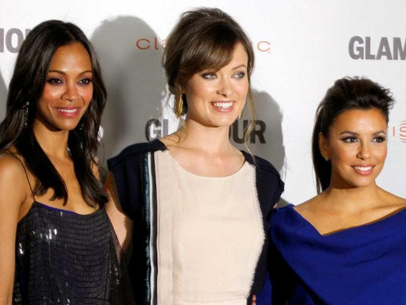 Zoe Saldana, left, Olivia Wilde, center, and Eva Longoria pose together at a screening for Glamour Reel Moments in Los Angeles.