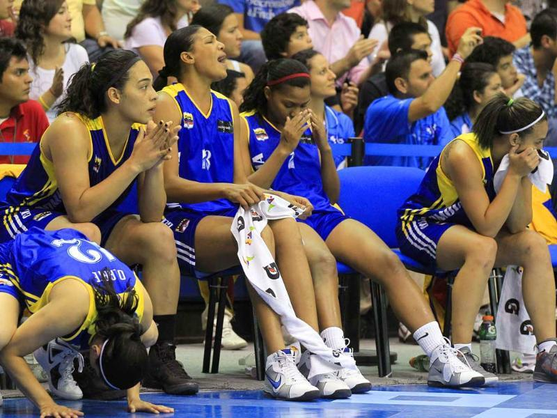 Colombia players react to a missed basket in the final minutes of their loss to Mexico during their women's semi-final basketball game at the Pan American Games in Guadalajara.