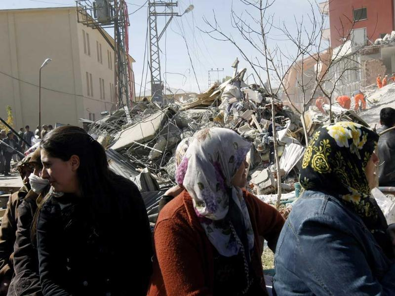 Women cry as rescuers work to save people from debris of collapsed buildings in Ercis, Van, eastern Turkey. At least 270 people are killed after a powerful quake in eastern Turkey and dozens of people are still trapped in hills of debris, but authorities hope the death toll may not rise as high as initially feared.