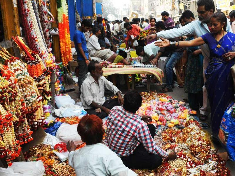 Customers shop for gifts and decorative items ahead of the forthcoming festival of Diwali at a busy market place in New Delhi.