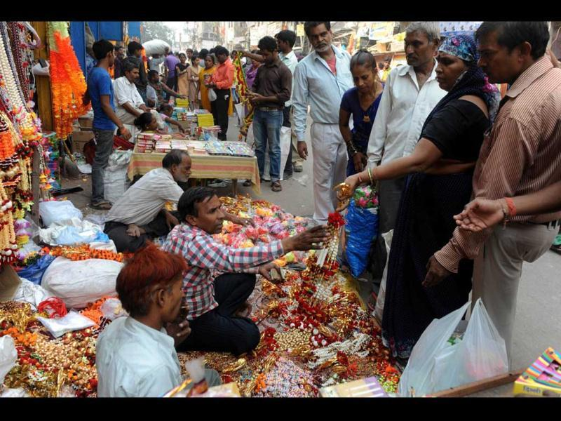 Customers shop for gifts and decorative items ahead of Diwali at a busy market place in New Delhi.