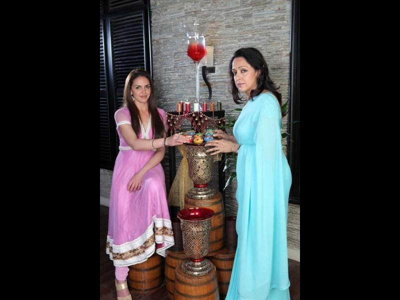 A puja thali in their hands and a prayer on their lips, mother-daughter duo Hema Malini and Esha Deol wish earnestly for the success of Tell Me O Khuda. The film releases on Diwali weekend. The two pose pretty for a Diwali shoot.