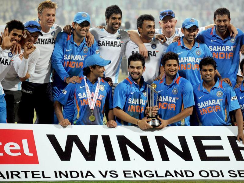 Indian players celebrate with their trophy after winning the final ODI match against England at Eden Gardens in Kolkata. (AFP)