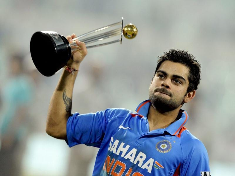 Virat Kohli posses with the trophy after India won the final ODI match against England, at Eden Gardens in Kolkata, and sweeped the series 5-0. (AFP)