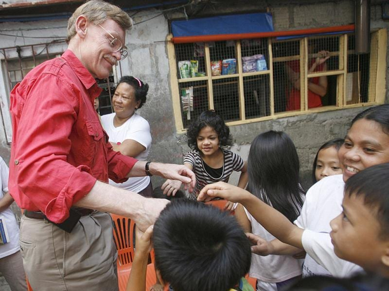 World Bank President Robert Zoellick smiles as children do 'Pagmamano', a Filipino gesture often done by young people to the elders as a sign or respect, during his visit to a bank-supported community in Pasay City, Metro Manila. The World Bank is providing $400 million via a 5-year loan that ends in 2014 to help fund the Philippines conditional cash transfer programme aimed at lifting health conditions and supporting basic education for the poorest of the poor.