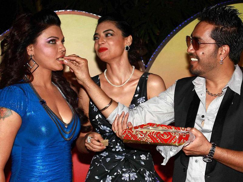 Bollywood item girl Rakhi Sawant and singer Mika Singh during a promotional event of the film 'Loot' in Mumbai.