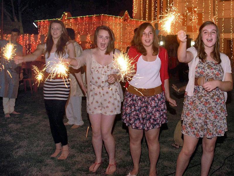 Students of Chosen Hill School, Gloucester, UK celebrate light fire crackers on the eve of 'Diwali' during their visit to participate in a student exchange programme in Bhubaneswar.