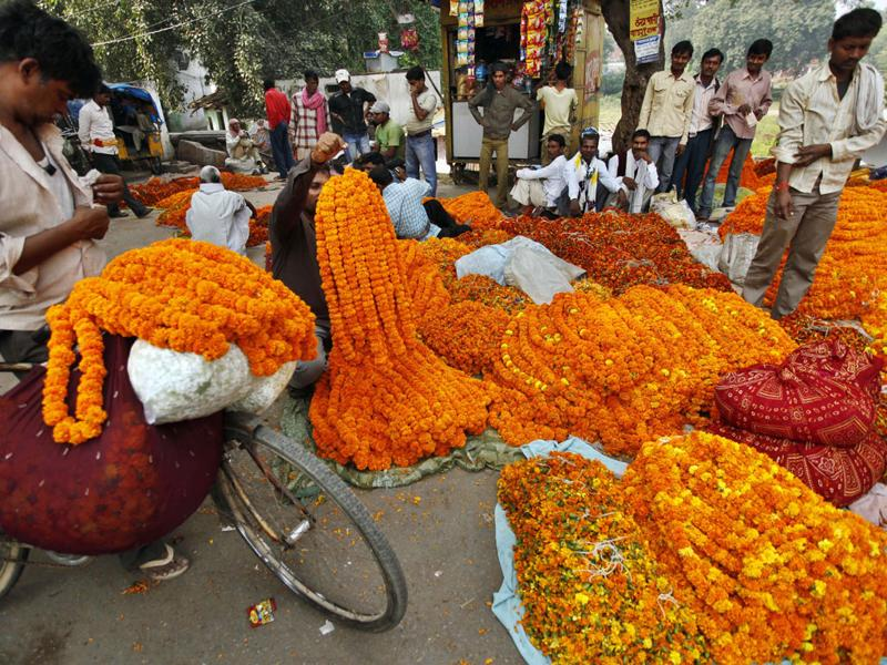 Roadside vendors sell marigold flower garlands on Diwali in Allahabad, India. Diwali, the Hindu festival of lights marks the victory of good over evil and light over darkness.