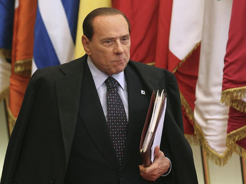 Italian Prime Minister Silvio Berlusconi leaves after an EU summit in Brussels.