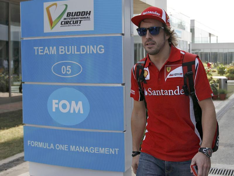 Ferrari Formula One driver Fernando Alonso of Spain walks in the paddock area at the Buddh International Circuit in Greater Noida.