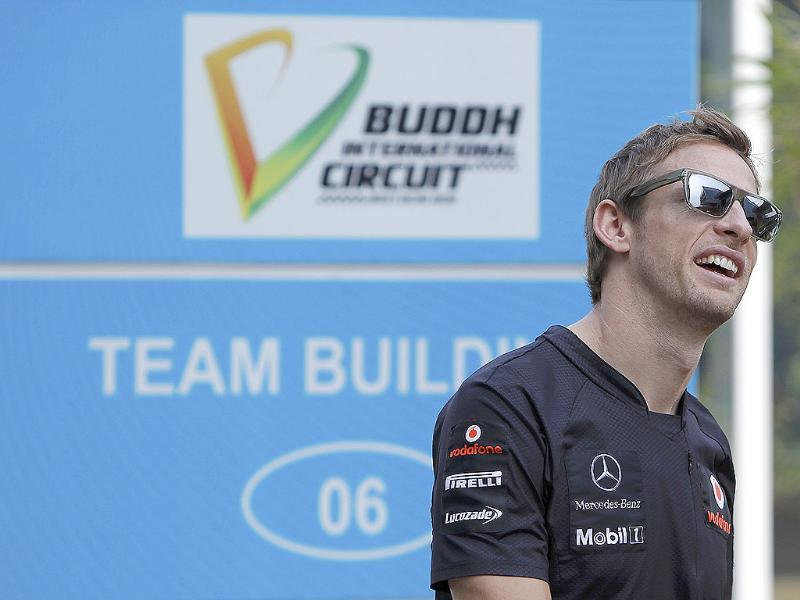 McLaren Formula One driver Jenson Button of Britain walks in the paddock area at the Buddh International Circuit in Greater Noida.