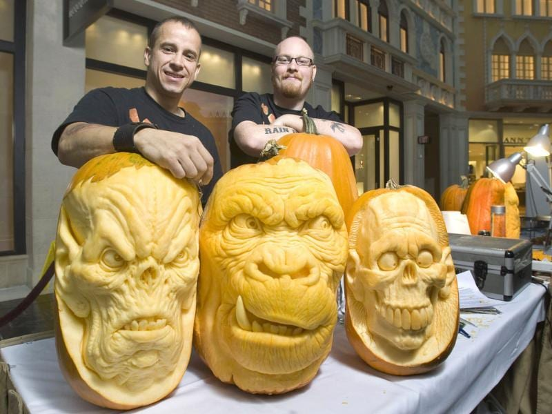 Artists Ray Villafane (L) and Andy Bergholtz pose during a pumpkin carving exhibition in the Grand Canal Shoppes at the Venetian hotel-casino in Las Vegas, Nevada.