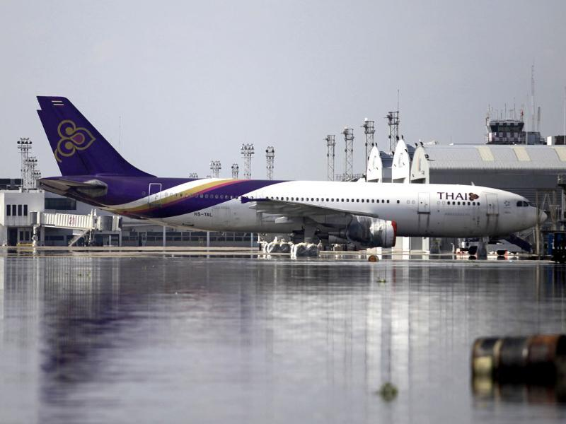 A Thai Airways' aircraft is parked at the flooded maintenance center in Don Mueang airport in Bangkok, Thailand. (AP)
