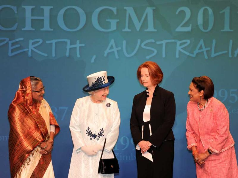 Britain's Queen Elizabeth II (2nd L) chats to Bangladesh Prime Minister Sheikh Hasina (L), Australian PM Julia Gillard (2nd R) and Trinidad and Tobago PM Kamla Persad-Bissessar at the Commonwealth Heads of Government Meeting in Perth.