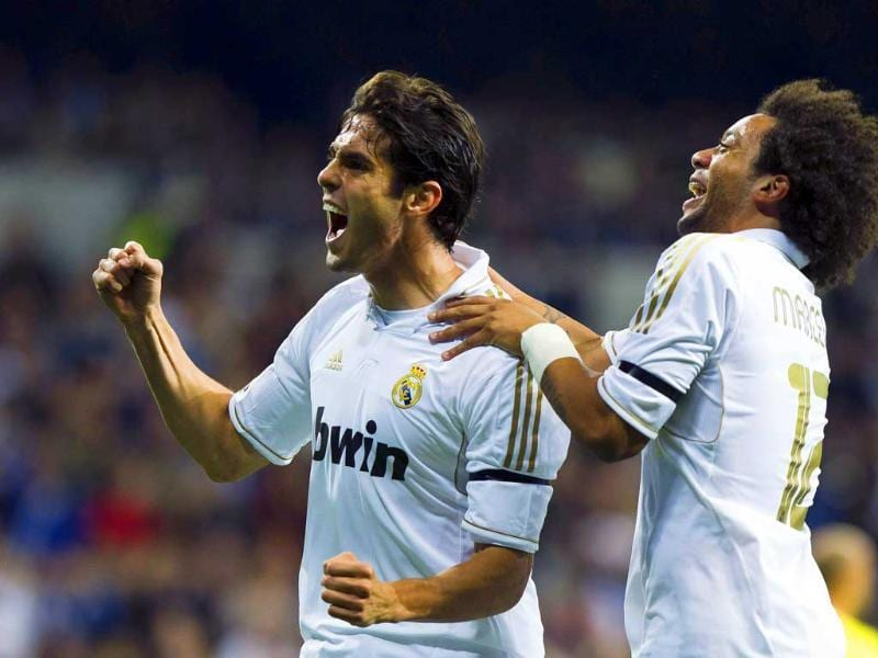 Real Madrid's Kaka from Brazil celebrates with Brazilian team mate Marceloa after scoring against Villarreal during a Spanish La Liga soccer match at Santiago Bernabeu stadium in Madrid, Spain.